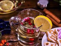Top view of glass mug and Christmas plate cookies. Stock Photo