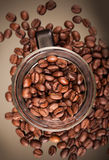 Top view of glass mug with coffee beans Stock Photos