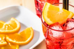 Top of view of glass of spritz aperitif aperol cocktail with orange slices and ice cubes Stock Photo