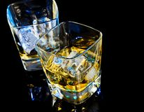 Top of view of glass of whiskey on black table with reflection Stock Photos