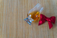 Top view for a glass of whiskey single malt, red bow Stock Photos