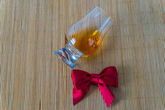 Top view for a glass of whiskey single malt, red bow Royalty Free Stock Photos