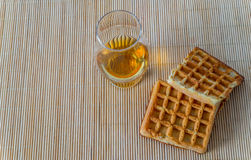 Top view for a glass of whiskey single malt, waffle Stock Photo
