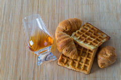 Top view for a glass of whiskey single malt, waffle and croissan Royalty Free Stock Photography