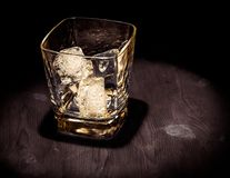 Top of view of glass of whiskey on wood table, warm atmosphere, time of relax with whisky Stock Photo