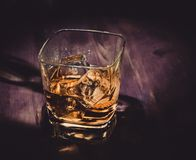 Top of view of glass of whiskey on wood table, warm atmosphere, time of relax with whisky Stock Images