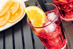 Top of view of glasses of spritz aperitif aperol cocktail with orange slices and ice cubes near plate of slices oranges Stock Images