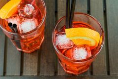 Top of view of glasses of spritz aperitif aperol red cocktail with orange slices and ice cubes Stock Images
