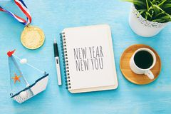 Top view 2019 goals list with notebook, cup of coffee over wooden desk. royalty free stock photo