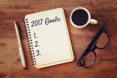 Top view 2017 goals list with notebook, cup of coffee Stock Images