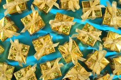 Top view of golden gifts close-up on a blue royalty free stock image
