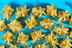 Top view of golden gifts close-up on a blue royalty free stock photo