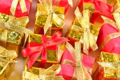 Top view of golden and red gifts close-up stock photo