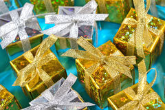 Top view of golden and silver gifts close-up on a blue stock photo