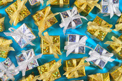 Top view of golden and silver gifts close-up on a blue royalty free stock images