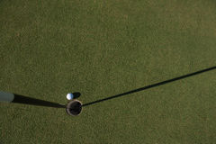 Top view of golf ball in the hole Royalty Free Stock Photo