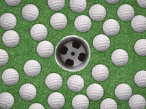 Top view golf balls with empty golf cup. On green background Stock Photos
