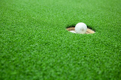 Top view of golf balls stacked up in green field. Royalty Free Stock Photography