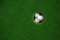 Top view of golf balls stacked up in green field Stock Photos