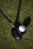 Top view of golf club and ball in grass. On course preparing for shot Royalty Free Stock Photo