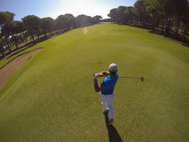 Top view of golf player hitting shot Royalty Free Stock Image