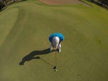 Top view of golf player hitting shot Stock Photos