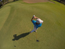 Top view of golf player hitting shot Royalty Free Stock Photography