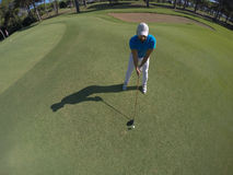 Top view of golf player hitting shot Stock Photo