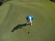 Top view of golf player hitting shot Royalty Free Stock Photo