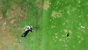 Top view of a golf strike made by the male golfer