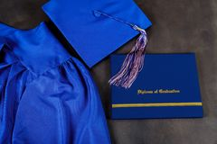 Top view of graduation mortarboard and certificate graduation on dark background, education concept royalty free stock images