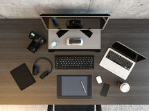 Top view of graphic designer desktop. With laptop, digital graphic tablet, DSLR camera, wireless headphone and keyboard. 3D rendering image Royalty Free Stock Images