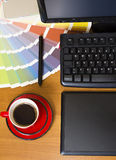 Top view of graphic designer work place. Top view drawing board, coffee cup and keyboard an color pallete Stock Images