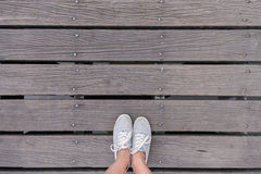 Top view gray sneakers on bridge, Hipster style Royalty Free Stock Image