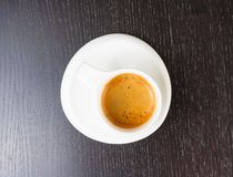 Top of view of great italian coffee in a white cup on black wood table Stock Photos
