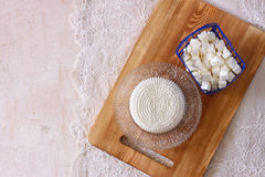 Top view of greek cheese and bulgarian cheese on wooden table over wooden textured background. Symbols of jewish holiday - Shavuot Stock Photo
