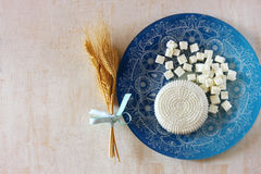 Top view of greek cheese and bulgarian cheese on wooden table over wooden textured background. Symbols of jewish holiday - Shavuot.  Royalty Free Stock Photo