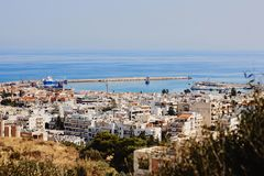 Top view of the Greek city Rethymno, harbor and Aegean Sea, Crete, Greece. Top view of the Greek city Rethymno, harbor and Aegean Sea in the summer, Crete stock images