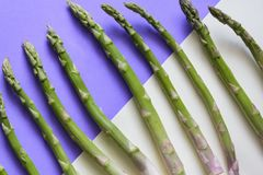 Top view of green asparagus against colorful background.  stock photography