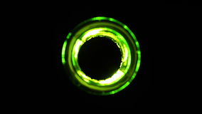 TOP VIEW: Green beer bottle fast lights on and off on black background stock video footage