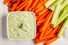 Top view of green dip with carrots and celery. Creamy radish kale dip with carrots and celery top view Stock Images