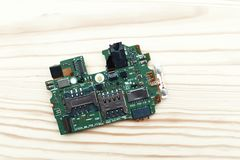 Top view of green electronic board of smartphone stock images