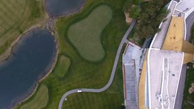 Top view green golf course outdoor green grass field. Aerial view from flying drone. Stock Image