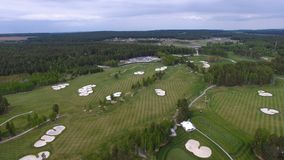 Top view green golf course outdoor green grass field. Aerial view from flying drone. Stock Photography