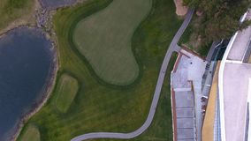 Top view green golf course outdoor green grass field. Aerial view from flying drone. Royalty Free Stock Photos