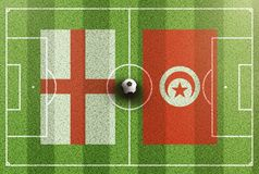 Top view of green soccer field with flags of England and Tunisia Royalty Free Stock Photos