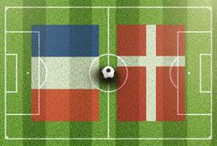 Top view of green soccer field with flags of France and Denmark Royalty Free Stock Photography