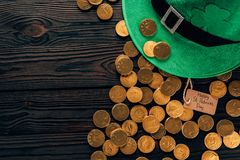 Top view of green hat and golden coins, st patricks day concept royalty free stock photo