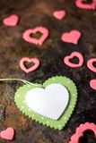 Top view of green heart with the pink hearts over black background. Top view of green heart with the pink hearts over black background Stock Photo