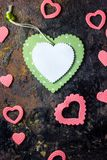 Top view of green heart with the pink hearts over black background. Top view of green heart with the pink hearts over black background Royalty Free Stock Images